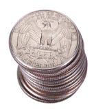 Pila isolata della moneta del dollaro quarto Fotografia Stock