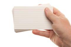 Pila maschio della holding della mano di schede istantanee Fotografia Stock Libera da Diritti