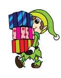 Pila que lleva del muchacho del duende de la Navidad de regalo imagen de archivo
