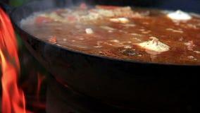 Pilaf Afghan, Uzbek, Tajik national cuisine dish preparation garlic addition stock video