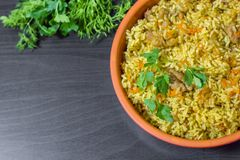 Pilaf with beef, carrots, onions, garlic, pepper and cumin. A traditional dish of Asian cuisine. Selective focus Stock Photos