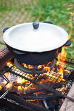 Pilaf cauldron with the lattice barbecue. Stock Photo