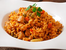 Pilaf with chicken, carrot and green peas Stock Photos