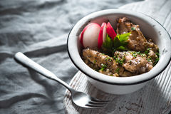 Pilaf with chicken in a metal bowl and radishes side view Royalty Free Stock Photos