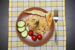 Pilaf with chicken pita bread and vegetables Royalty Free Stock Photo