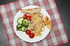 Pilaf with chicken pita bread and vegetables Royalty Free Stock Images