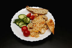 Pilaf with chicken pita bread and vegetables Stock Images