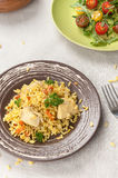Pilaf with chicken and vegetable salad Stock Photos