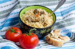 Pilaf con la carne y las verduras fotografía de archivo