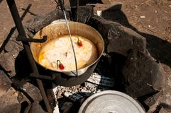 Pilaf is cooked on the fire in nature Royalty Free Stock Images