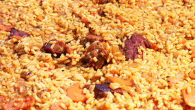 Pilaf cooking close-up. Pilaf cooked. Delicious food meat rice vegetable and seasonings Royalty Free Stock Photo