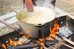 Pilaf cooking on a fire Royalty Free Stock Image