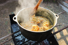 Pilaf cooking on a fire. Royalty Free Stock Photo