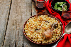 Pilaf with dates, figs and chicken Stock Image