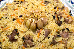 Pilaf - Eastern food - rice, oil, meat and spices Royalty Free Stock Photography