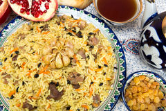 Pilaf - Eastern food - rice, oil, meat and spices Royalty Free Stock Photo