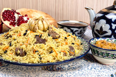 Pilaf - Eastern food - rice, oil, meat and spices Stock Images