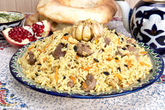 Pilaf - Eastern food - rice, oil, meat and spices Stock Photos