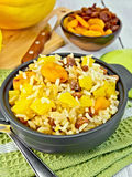 Pilaf fruit with pumpkin in pan on board Stock Photo
