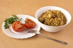 Pilaf i pomidory Zdjęcia Stock