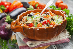 Pilaf made ​​of wheat grains and vegetables Stock Image