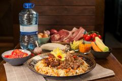 Pilaf. Meat dish of the peoples of Central and Central Asia, rice, meat and onions, suitable for the Nauryz or Navruz holidays, as stock image