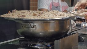 Pilaf with meat in a large cauldron in the hotel restaurant.Traditional Indian dish or Middle Eastern rice cooked with stock footage