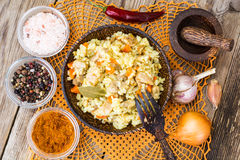 Pilaf with meat, rice and zira in a wooden bowl Royalty Free Stock Photo