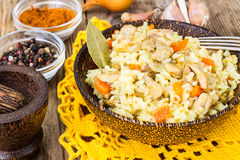 Pilaf with meat, rice and zira in a wooden bowl Stock Photography