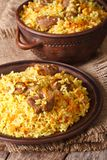 Pilaf with meat and vegetables closeup vertical Stock Image