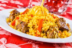 Pilaf with meat and vegetables. On white plate Royalty Free Stock Photos