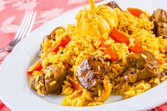 Pilaf with meat and vegetables. On white plate Royalty Free Stock Photo