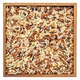 Pilaf mix in a isolated wooden box Stock Images