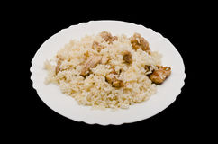 Pilaf on plate. Isolated on black background Royalty Free Stock Photo