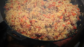 Pilaf (Plov) - Afghan, Uzbek, Tajik national cuisine main dish stock video footage