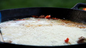 Pilaf (Plov) - Afghan, Uzbek, Tajik national cuisine main dish preparation - water addition Royalty Free Stock Photo