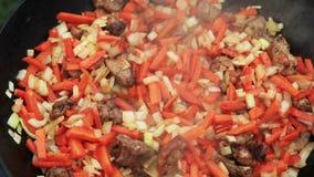 Pilaf (Plov) preparation - Afghan, Uzbek, Tajik national cuisine main dish stock video footage