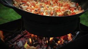 Pilaf (Plov) preparation - Afghan, Uzbek, Tajik national cuisine main dish Stock Photography