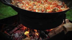 Pilaf (Plov) preparation - Afghan, Uzbek, Tajik national cuisine main dish stock video