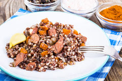Pilaf with red rice with chunks of beef, carrots and garlic. Studio Photo Stock Images