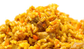 Pilaf from rice and meat. It is prepared with karri and carrots Royalty Free Stock Photo