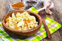 Pilaf, rice, meat, carrots, garlic Royalty Free Stock Photography