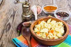 Pilaf, rice, meat, carrots, garlic Royalty Free Stock Image