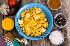 Pilaf with rice, meat, carrots and pumpkin juice Stock Photography