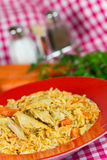 Pilaf,a rice meat with chicken and carrots Royalty Free Stock Image