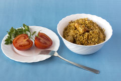 Pilaf and tomatoes on blue background Stock Images