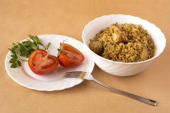 Pilaf and tomatoes Stock Photos
