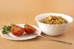 Pilaf and tomatoes Stock Images