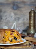 Pilaf in tortillas with dried fruits, garlic and burberry Stock Photo