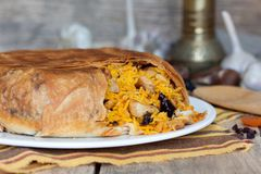 Pilaf in tortillas with dried fruits, garlic and burberry. Pilaf in tortillas (Azerbaijan shah pilaf) with dried fruits, garlic and burberry on white plate Stock Photo